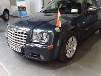 "Chrysler 300C with a magnetic car flagpole ""SteelEx"" modern"